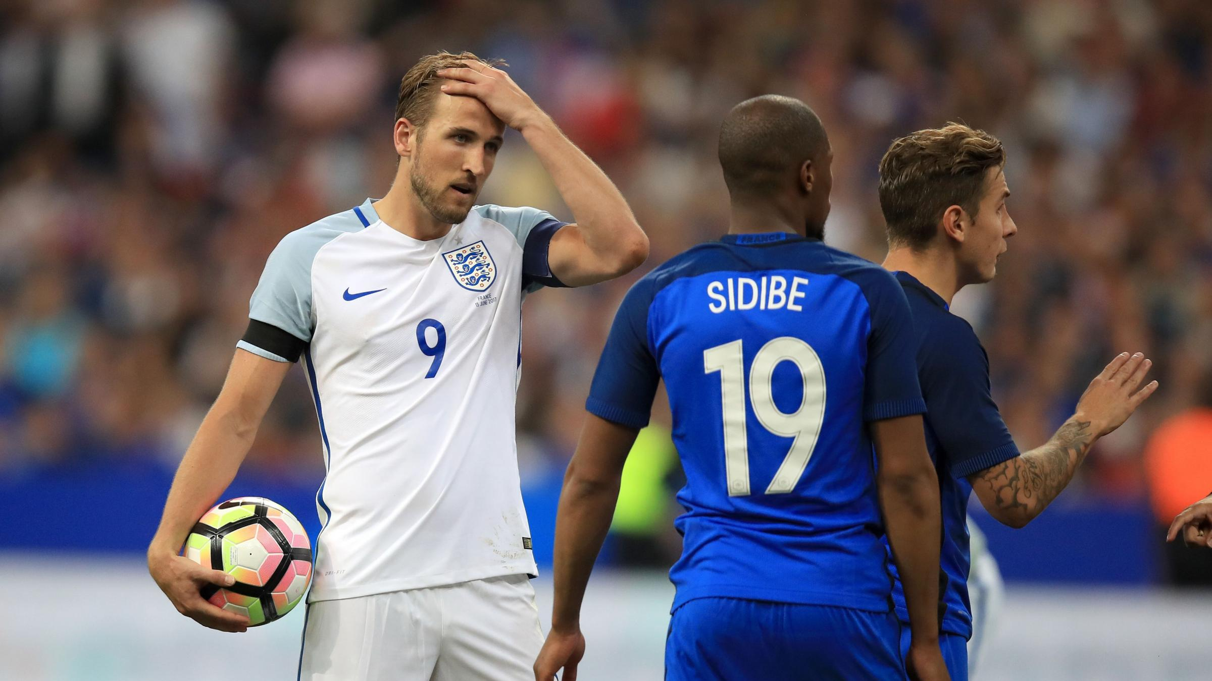 Ten-man France down England in lively friendly